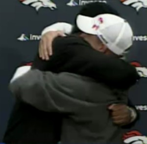 Sharing a hug at the press conference